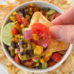 a chip dipped in texas caviar dip
