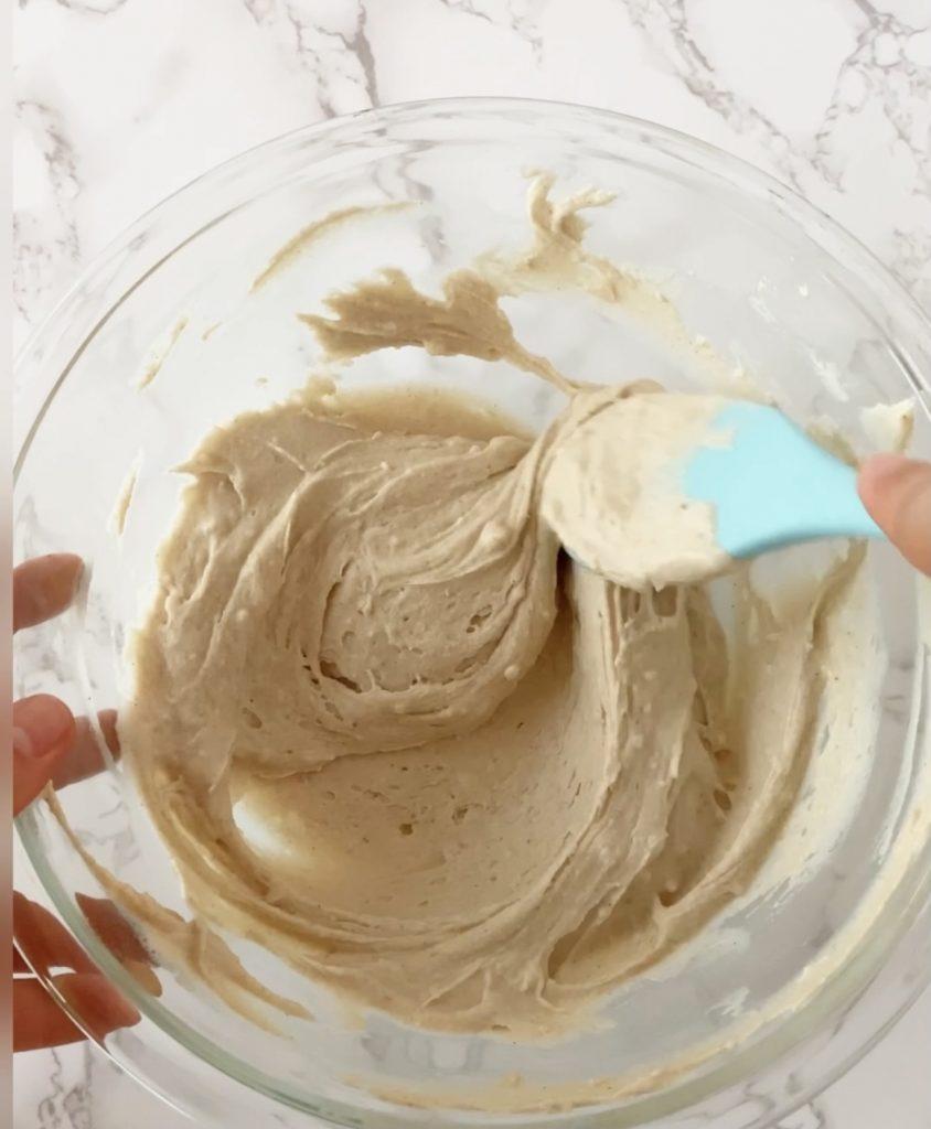mixing pancake batter in a bowl