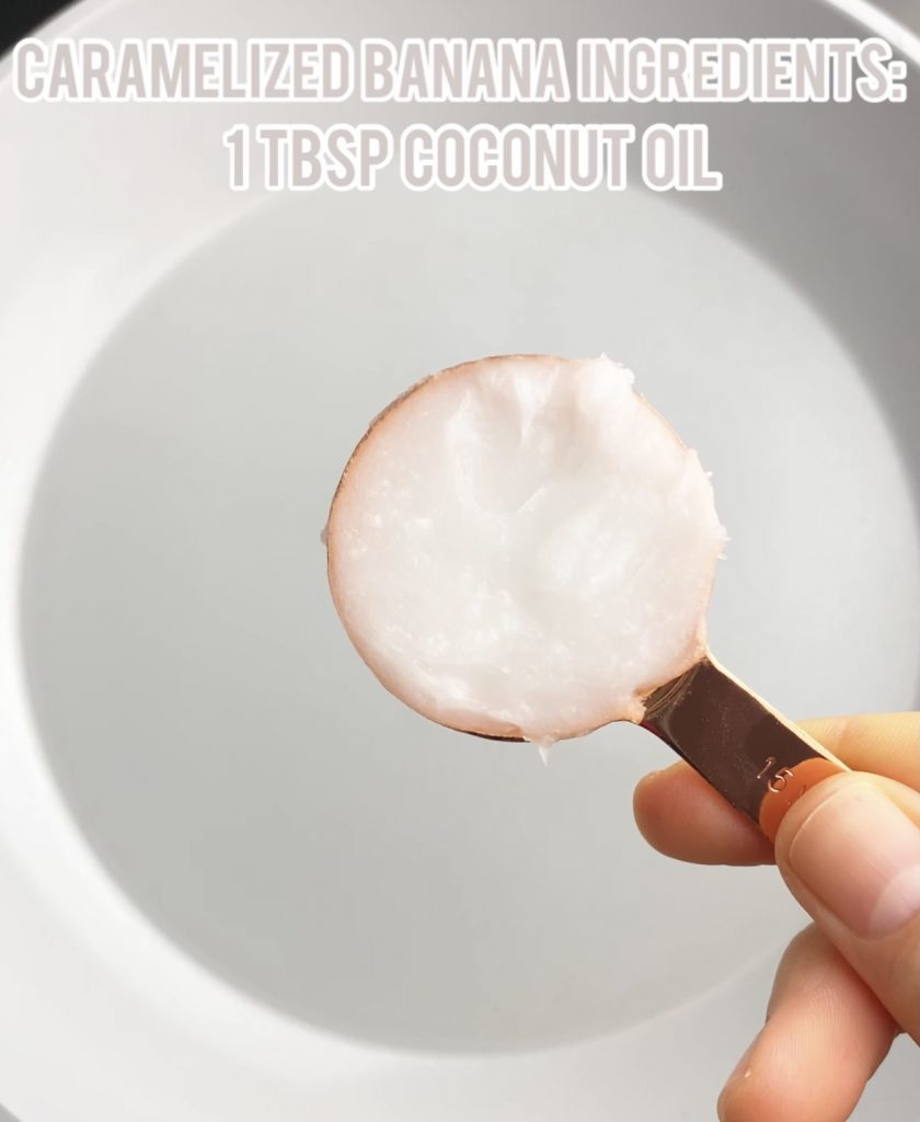 coconut oil in a measuring spoon over a pan
