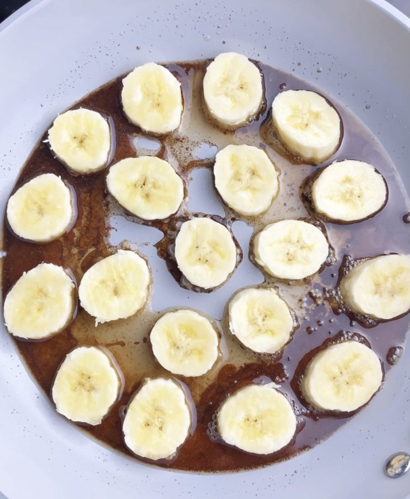 bananas frying on a pan