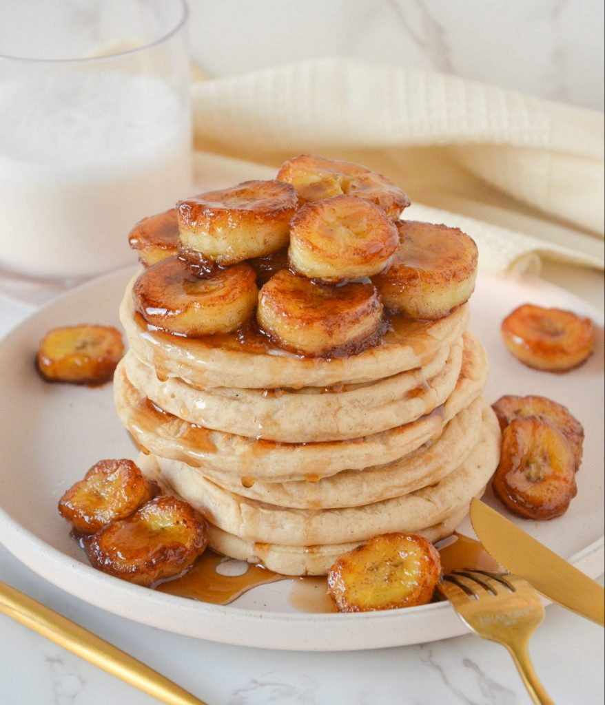 pancakes on a plate with bananas on top