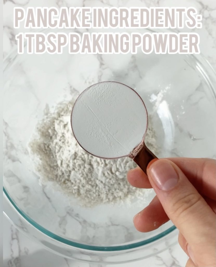 baking powder in a measuring cup over a bowl