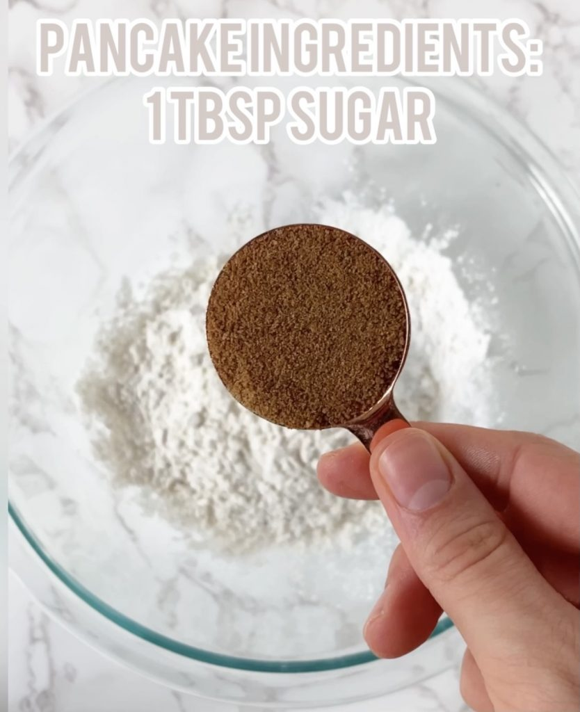 coconut sugar in a measuring cup over a bowl