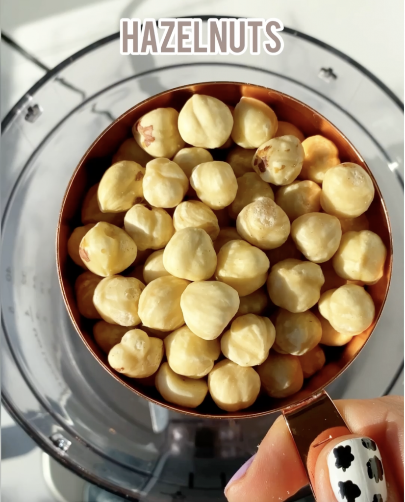 hazelnuts in a measuring cup