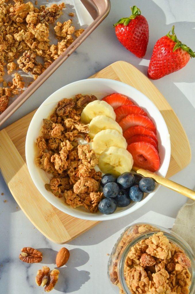 granola in a bowl with yogurt and fruit