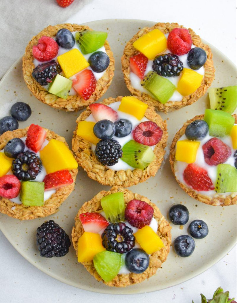 overhead shot of granola cups filled with yogurt and fruit