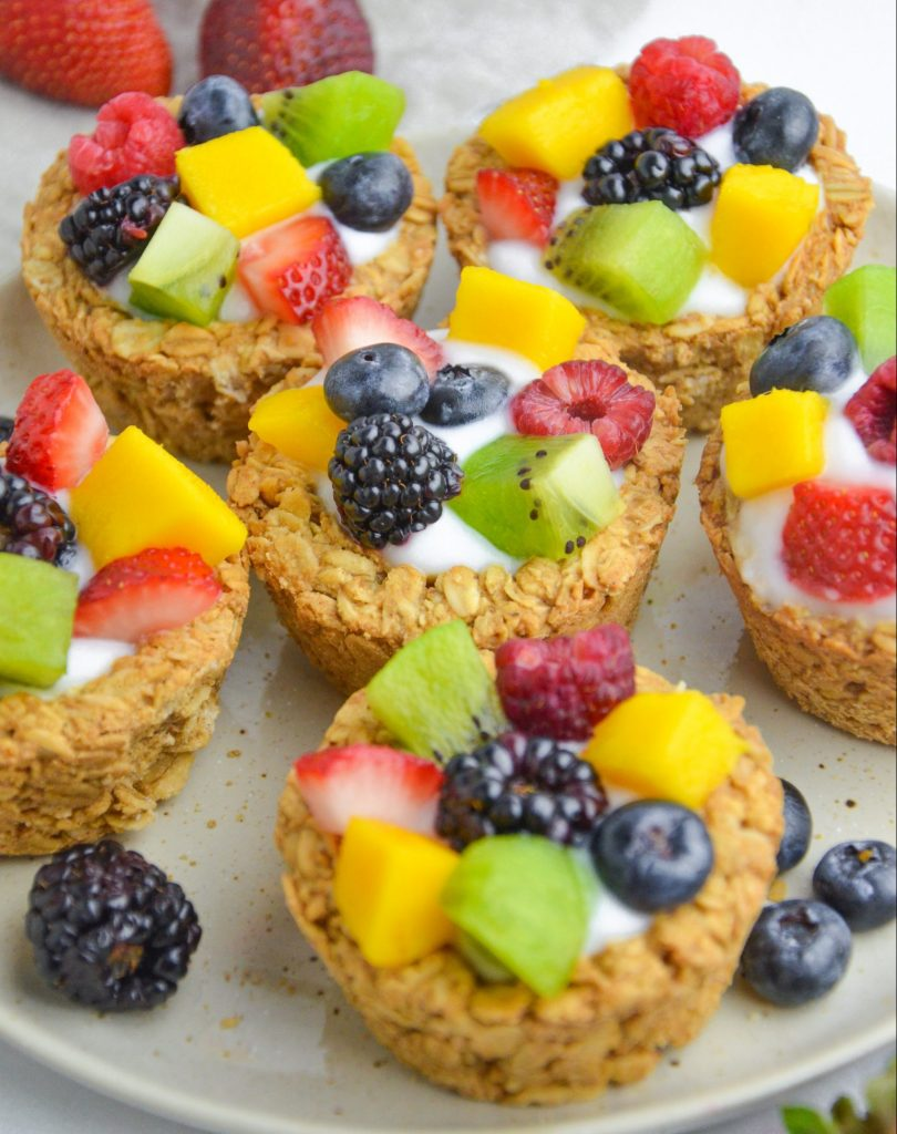 granola cups filled with yogurt and fruit