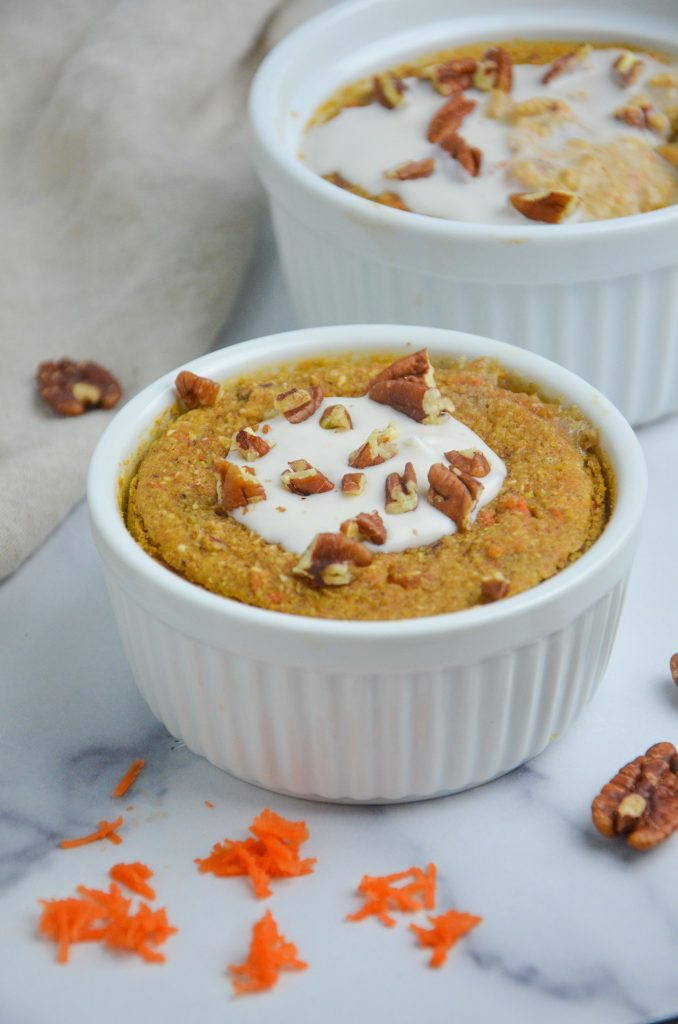 carrot cake oats in a bowl with white frosting on top