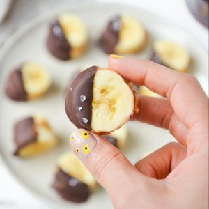 closeup of a banana slice with peanut butter chocolate and flakey salt